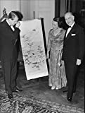 Vintage photo of Robert Carl Bildt and his wife Harriet admire Japanese painting held up by his son Robert at the family39;s genealogy association meeting in the House of Nobility.