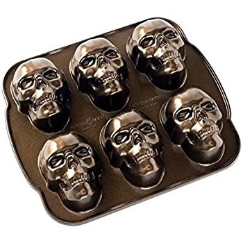 Amazon Com Nordic Ware Haunted Skull Cakelet Pan Kitchen