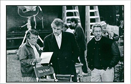 "Vintage photo of Robert Evans, Phillip Noyce, and Howard Koch Jr. preparing on the set for the film ""Sliver""."