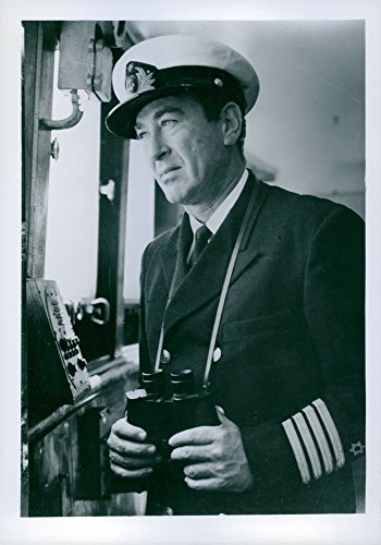 Vintage photo of Captain Jacob Jacobson, captain of Israel39;s first major Trans Atlantic Liner, the SS Jerusalem holding binoculars. The photo was taken during the Eichmann - Atlantic Liner