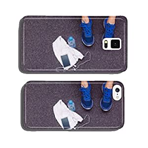 Man legs with sneakers, towel, water and smartphone in gym floor cell phone cover case Samsung S5