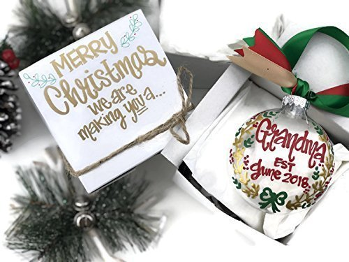 hand painted christmas baby announcement ornament with gift box merry christmas we are making