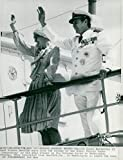 Vintage photo of Queen Margrethe II of Denmark and Prince Henrik wave from the bridge to the Danish yacht'Danneborg'