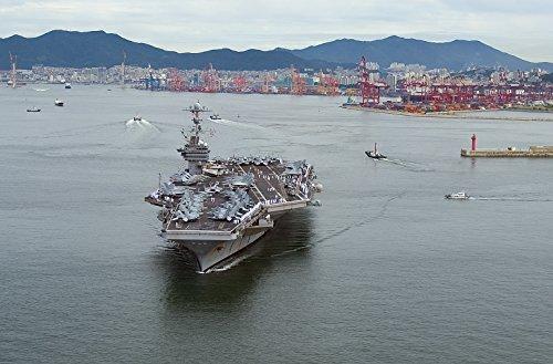 Home Comforts The Aircraft Carrier USS George Washington (CVN 73) departs Busan, Republic Korea. The Republic o