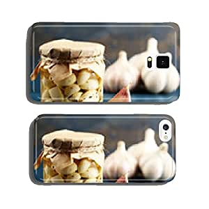 Canned garlic in glass jar on color wooden background cell phone cover case Samsung S6