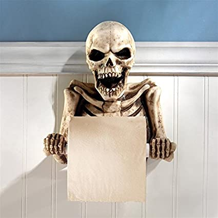 Skeleton skull sculpture wall mounted holding toilet paper black wall