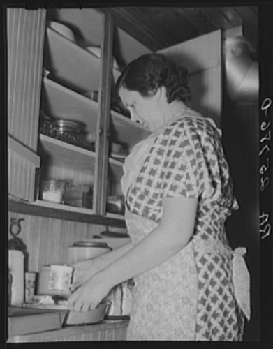 Photo: Mrs. McNally baking a cake for dinner. Kirby,Vermont (Kirby Cake)