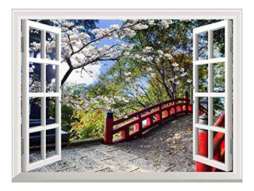 White Window Looking Out Into a Red Bridge Surrounded by Beautiful Trees Wall Mural
