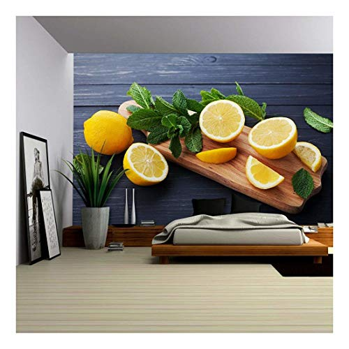 wall26 - Lemon and Mint Leaves Served on Wooden Kitchen Board on Black Rustic Table - Removable Wall Mural | Self-Adhesive Large Wallpaper - 66x96 inches ()