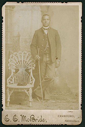 1880 Photo Buffalo Soldier, 9th Cavalry, Company D, sharpshooter collar insignia] / C. C. McBride, Crawford, Nebraska. a full-length portrait of an African American soldier, standing next to chair, hi