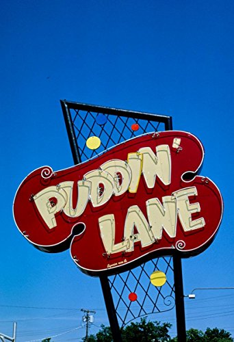 Weatherford Collection - Roadside America Photo Collection | 1982 Puddin' Lane IGA sign, Weatherford, Oklahoma | Photographer: John Margolies | Historic Photographic Print 16in x 24in