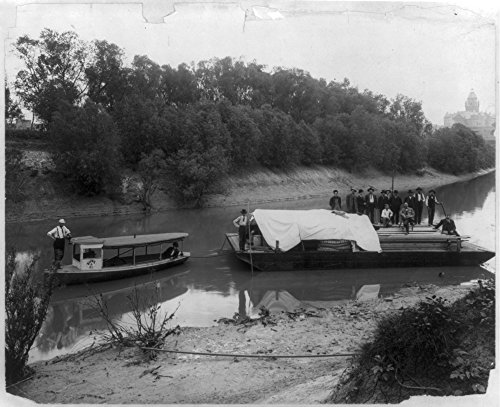 1906 Photo First barge loaded with supplies leaving Dallas port for the first dock and dam on the Trinity River, Texas. Barge drawn by Burk & Co. - Burk Photography