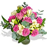 Fresh Pink Delights Flowers with FREE Delivery - A beautiful bouquet filled with Pink Roses and White Freesias hand tied in matching cellophane using real floristy skills and a big hand made bow