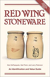 This is a 6 GALLON RED WING CROCK with the WINGED RED LOGO on the.