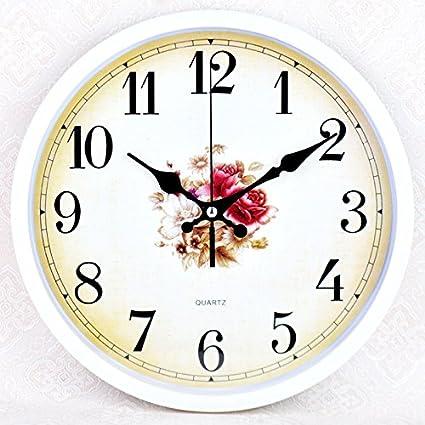 Amazon.com: Living room wall clock watch simple cartoon clocks, quartz clock Bizhong wall clock,l26cm: Home & Kitchen