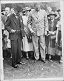 Vintage photo of Arthur Neville Chamberlain fishing for bottles at the Fete at Ormsby Hall. 1937.