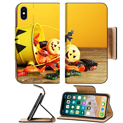 MSD Premium Apple iPhone X Flip Pu Leather Wallet Case IMAGE ID 33459530 Different sweets for Halloween party on wooden table on yellow (Halloween Sweets Table)