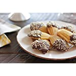 USA Pan Bakeware Madeleine, Warp Resistant Nonstick Baking Pan, Made in The USA from Aluminized Steel, 16-Well, Silver 10 Perfect for delicious French madeleines that bake evenly and taste great; heavy gauge aluminized steel that is commercial grade USA Pan baking pans feature Americoat which promotes quick release of baked-goods plus fast and easy clean up; wash with hot water, mild soap and gentle scrub brush or sponge Nonstick Americoat coating - a patented silicone coating which is PTFE, PFOA and BPA free - provides quick and easy release of all baked-goods and minimal easy clean up