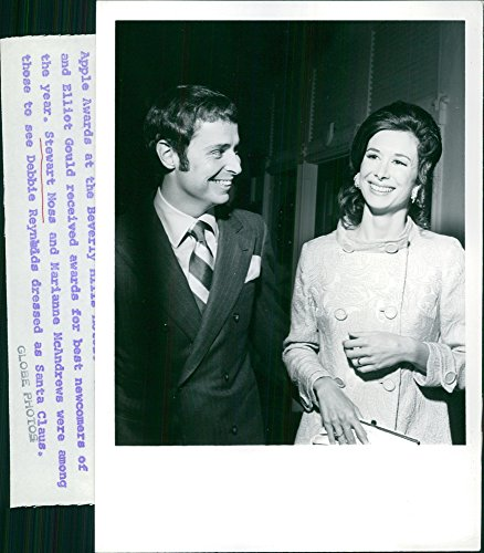 Superior photo of Stewart Moss and Marianne McAndrew smiling.