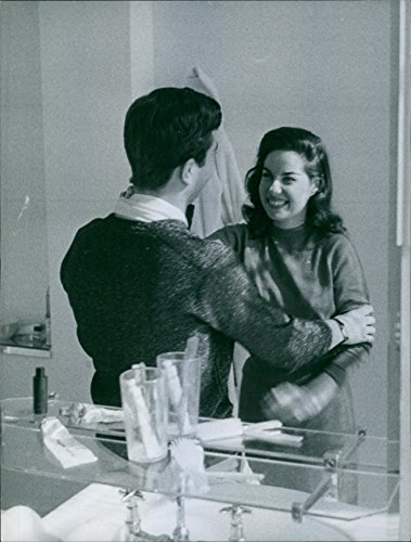 - Vintage photo of Reflection in mirror of Jacqueline Boyer and man.