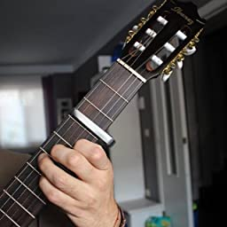 Anpro Cejilla Capo para Guitarra (plata) +6 Púas(0,46, 0.71mm cada ...