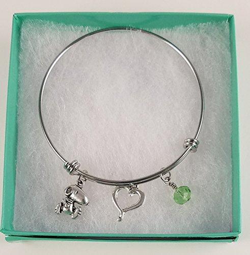 Snoopy Stainless Steel Adjustable Bangle Charm Bracelet with Open Heart and Peridot Green Dangle.]()