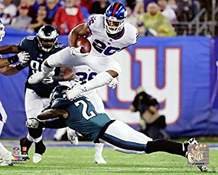 online store c75cc 2aa24 Amazon.com: New York Giants Saquon Barkley Leaping over The ...