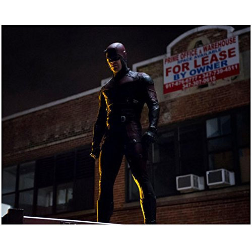 Daredevil (TV Series 2015 - ) 8 inch x 10 inch Photo Charlie Cox in Leather Costume Standing on Roof Top Next Brick Building for Lease kn]()