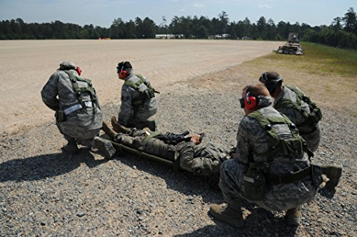 Airmen With The 88Th Medical Support Group  Wright Patterson Air Force Base  Ohio  Prepare To Lift A