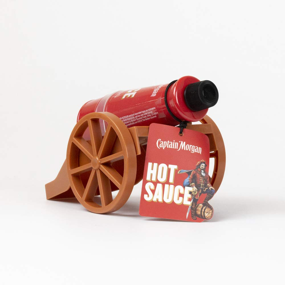 The Captain's Hot Sauce Cannon from Captain Morgan | Hot Sauce in Cannon-Shaped Bottle with Cannon Stand