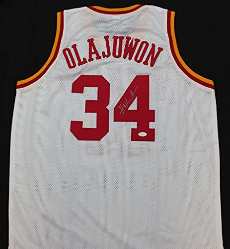 Hakeem Olajuwon Autographed White Houston Rockets Jersey - Hand Signed By Hakeem Olajuwon and Certified Authentic by JSA - Includes Certificate of Authenticity
