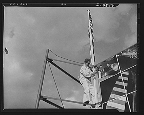1941-photo-four-freedoms-and-arsenal-of-democracy-posters-this-worker-is-completing-the-border-on-th