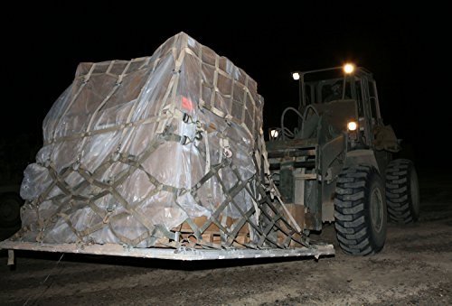 A military fork-lift, operated by Combat Logistics Battalion 3, moves provisions to the designated a