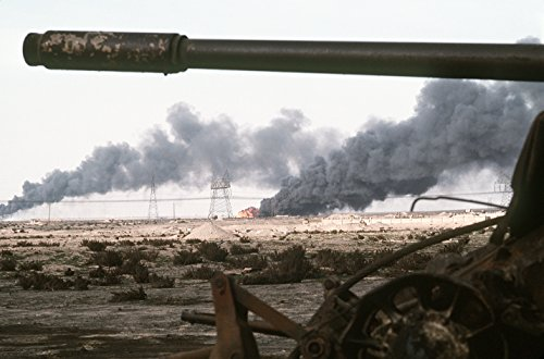 Home Comforts A Kuwaiti oil field set afire by retreating Iraqi troops burns in the distance beyond an abandoned I - Kuwaiti Oil
