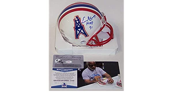 a02a5705584 Amazon.com  Earl Campbell Autographed Hand Signed Houston Oilers Mini  Football Helmet - with HOF 91 Inscription - BAS Beckett  Sports Collectibles