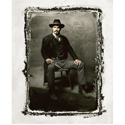 Deadwood Timothy Olyphant as Seth Bullock seated in chairperson holding gun sepia 8 x 10 Inch photo