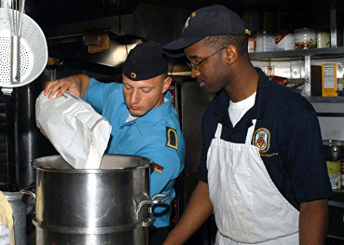 fan products of LAMINATED POSTER Culinary Specialist 3rd Class Andree Bode, of the German frigate FGS Bayern (F 217) pours flour int
