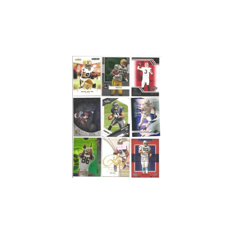 9   Card Lot of NFL Players . . . All Are Serial Numbered . . . Featuring 2003 Upper Deck Ultimate Collection Marshall Faulk #146/750 . . . 2003 Upper Deck Finite Mike Seidman #786/999 . . . 2008 Upper Deck ICONS Future Foundations Vince Young #591/750 . .