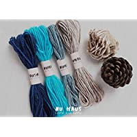 Paquete de hilos de lana teñidos a mano 'Agua' con elementos naturales