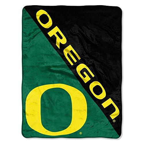 The Northwest Company Officially Licensed NCAA Oregon Ducks Halftone Micro Raschel Throw Blanket, 46