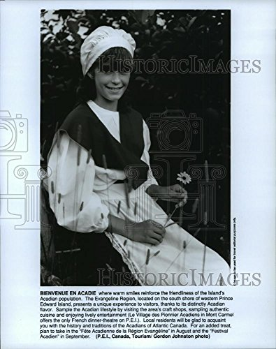 (Historic Images 1991 Press Photo Young Acadian girl with flower, Prince Edward Island, Canada - 10 x 8)