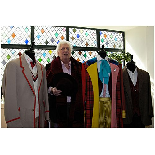 Tom Baker as Doctor Who Standing by Dr. Who Outfits 8 x 10 Inch Photo ()