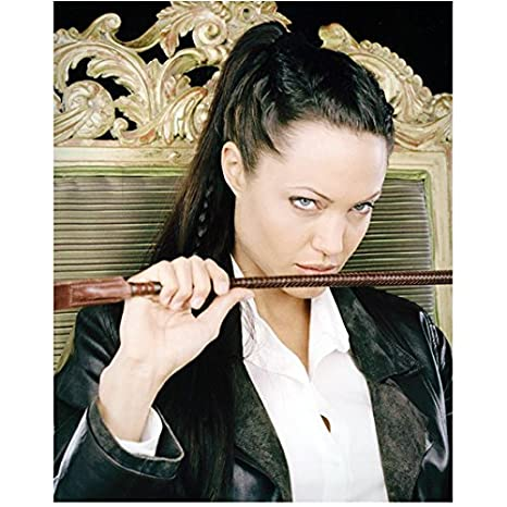 201f39ad991 Tomb Raider Angelina Jolie as Lara Croft Wearing White Shirt Black Leather  Jacket Hair Up Holding ...