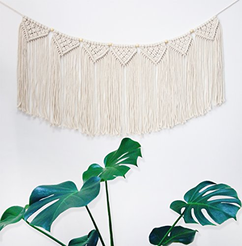 "Macrame Woven Wall Hanging Curtain Fringe Garland Banner - BOHO Shabby Chic Bohemian Wall Decor - Apartment Dorm Living… - Comes ready to hang. This macrame is hand knotted with high quality 6mm thickness cotton rope, and decorated with wooden beads. The woven banner has 7 tassels ""flags"" and the distance between each one can be easily adjusted. It measures approx. 35.0 inches from the first to the last flag. Meticulously handcrafted, creative design, after hours of knotting by our local artisans, using natural materials giving a minimalist feel and add some boho charm to your space. Looks an especially charming statement over your bed, your dresser, your couch, on the mantle, near a window or creatively placed across the frames on a gallery wall. - living-room-decor, living-room, home-decor - 51LHO0s7vdL -"