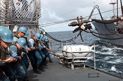 Home Comforts Sailors on Board The US Navy's Spruance Class Destroyer USS MOOSBRUGGER (DD 980) Heave Over a Fuel l ()