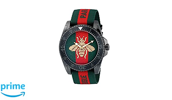7899395be969a Amazon.com  Gucci Quartz Stainless Steel and Nylon Casual Two-Tone Men s  Watch(Model  YA136216)  Watches