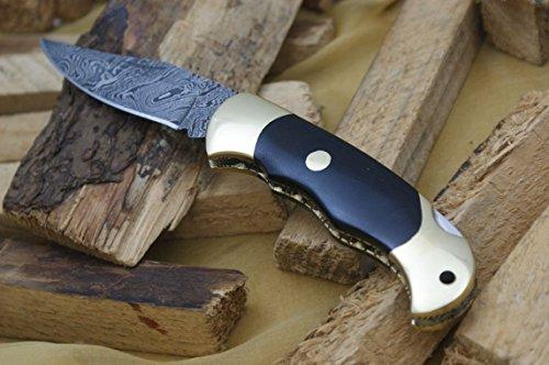 Knife King Damascus Lockback Folding knife. Micarta handle.Razor sharp. Solid quality hunter.Comes with a sheath.