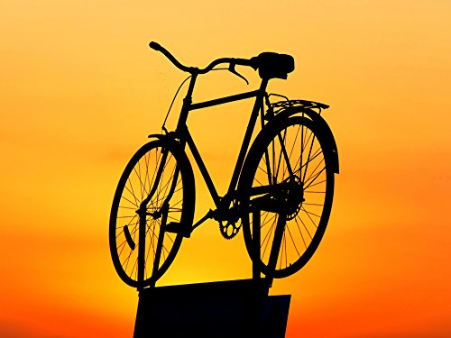 Home Comforts LAMINATED POSTER Silhouette Of Cruiser Bike During Sunset Sunset Poster Print 24 x 36 by Home Comforts