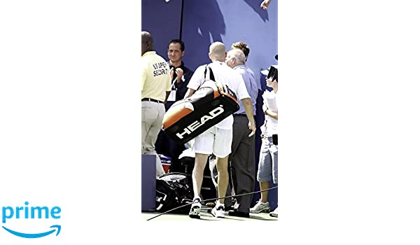 1b4007d9c052b Amazon.com: Andre Agassi carrying a bag Photo Print (24 x 30 ...