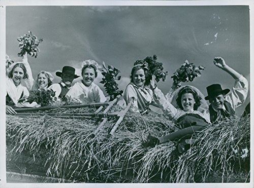 Vintage photo of With bouquets in hand and happy men beside them waving S246;rmlandsleden tots in the historic train hay cart to the spectators. - 10 June (1939 Bouquet)